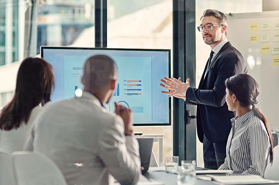 Office meeting explaining PBAC