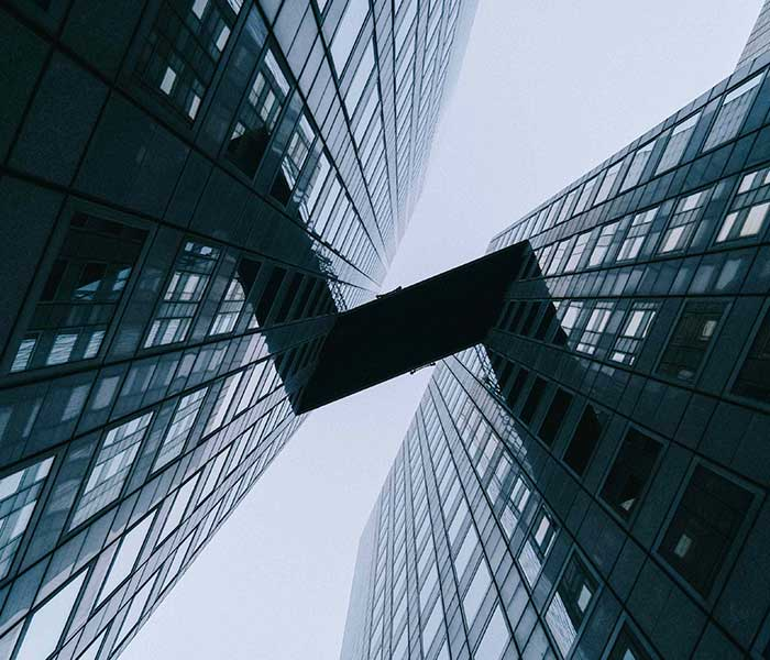 The underside of a bridge connecting two skyscrapers | Government cyber security